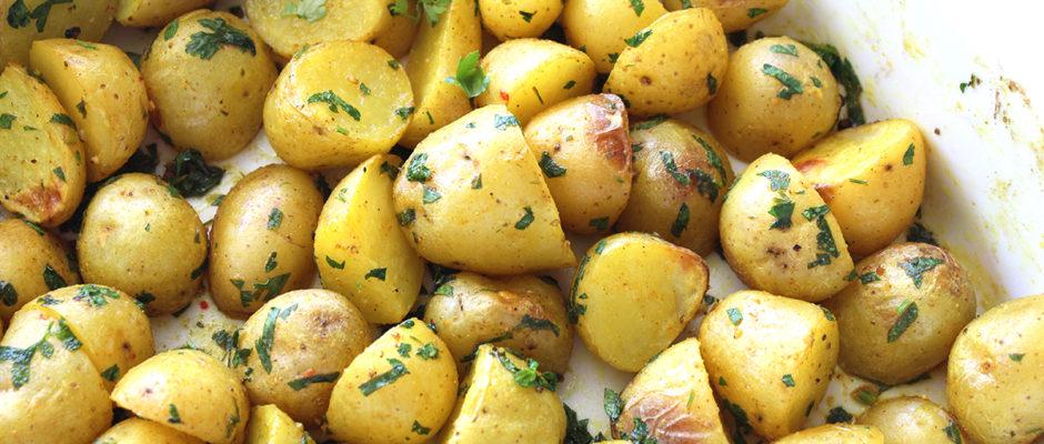 πατατες στο φουρνο με καρυ και κουρκουμα